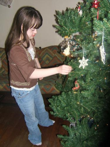 Vicky putting ornament on tree! - granddaughter putting ornament on tree
