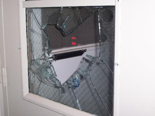My window - See that... that's safety glass. They had to ram the brick into it several times...
