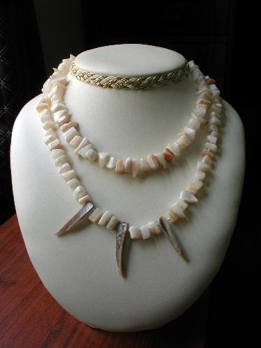 Mother-of-Pearl Necklaces - These necklaces are approximatly 15 inches long and are knotted between every bead.
