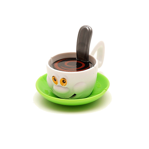 Do you leave the spoon/stirrer in the cup? - A picture of a cute cup with a stirrer. Photo source: http://farm1.static.flickr.com/72/163796078_df8db38b70.jpg?v=0 .