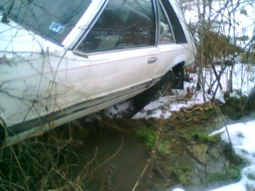 my car in the creek - This is where my car landed after sliding backwards down the driveway on the ice Sunday night (12-09-07)