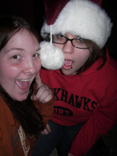 allie and me - Having fun with my Santa hat. Allie is wearing the Santa hat, the other one is me.