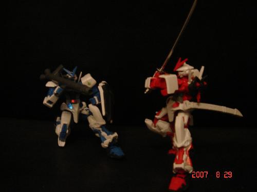 Gundam Astray Blue and Red Frame - Blue Frame with his bazooka and Red Frame with his samurai sword.