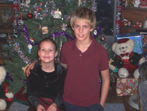 daughter and son - my daughter and son infront of our christmas tree this year.