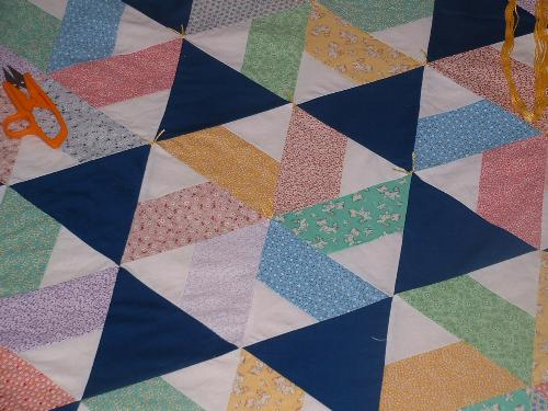 "close up of ""Triangle Tribulation"" - This is a quilt I made from my MIL. It's pattern was from a Fons and Porter magazine, their quilt was titled ""Wedding Wishes."""