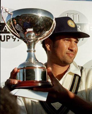 Sachin The legend - sachin tendulkar holding the trophy
