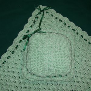 Baby Afghan & Pillow Set - crochetted this green baby afghan and pillow set are edged in forest green satin ribbon.