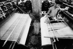 Child worker at a loom - The picture shows a child-loom-worker hard at work when he should be studying and spending a carefree stage of life, spending his time in eating, playing, quesioning, wondering, experiencing, knowing, understanding and realizing