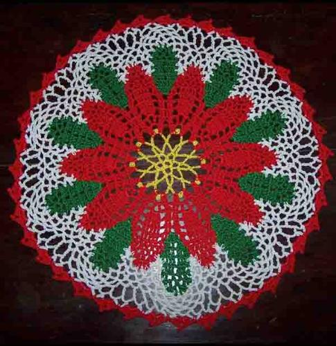 Poinsettia doily in crochet - I have used knitting cotton - red, white, yellow and green.