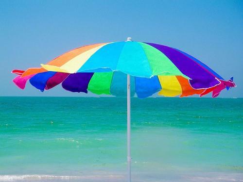 Summer Fun! - Just an umbrella on a beach in the summer sun...