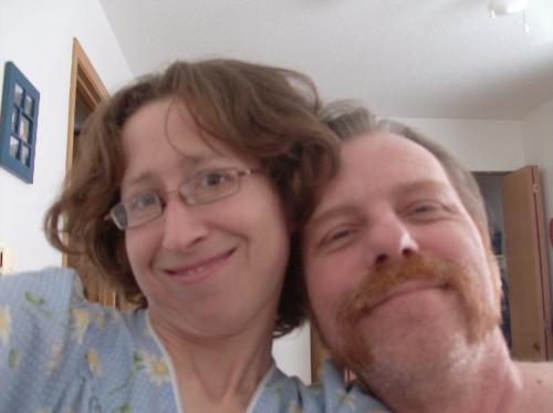William and I - My husband and I at home smiling at the camera for a kodack moment.