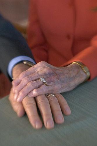 Together Forever... - An older married couple's hands and wedding rings...