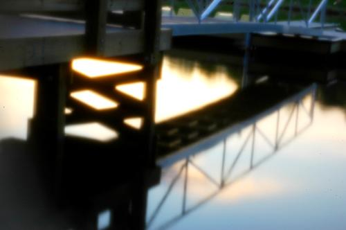 Digital Pinhole Photography - I took this photo of a bridge reflected in the water using a pinhole lens on a Nikon D70 DSLR.