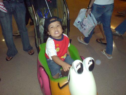 my bugoy - riding on a toy car doing a shopping at sm cebu. i got very tired at that day since my bugoy is sooooooo naughty.
