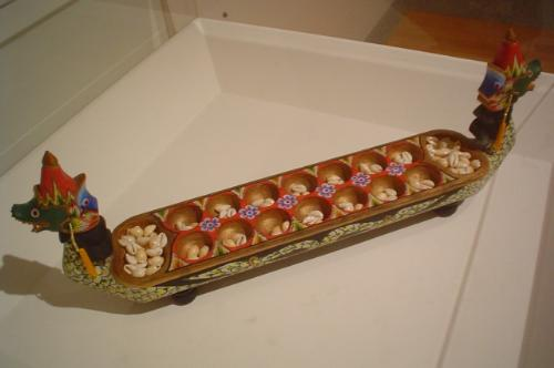 Congklak, a traditional games from Indonesia. The  - Congklak, a traditional games from Indonesia. The board made by wood.
