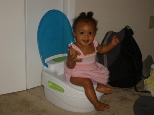 Jaylin sitting on the potty - Jaylin sitting on her potty. She has all her clothes on, but thinks this thing is hilarious!
