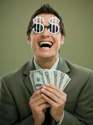 Make Money - Man holding lots of money, he is very happy