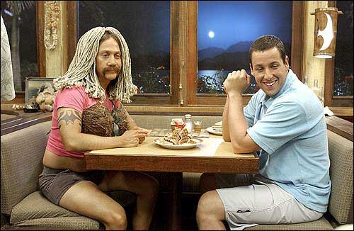 adam sandler and rob schneider - a picture of them during the film 50 first dates.        the host webpage http://www.lawrence.com/photos/2004/feb/13/1323