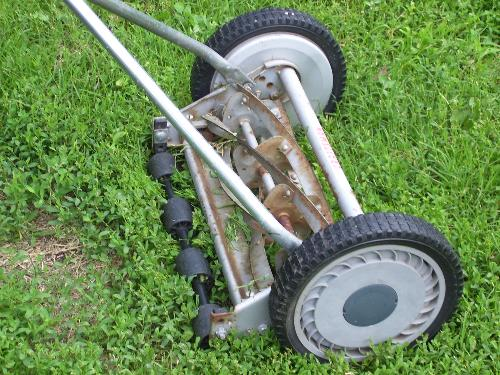 Push lawnmower. - I mowed with this this morning. It was hard work. Good for the environment, though.
