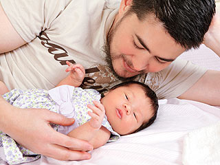 Pregnant Man and His Baby - The man who had got pregnant is seen here photographed with his newborn baby girl.