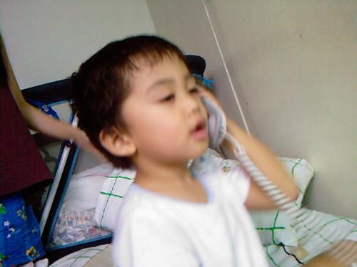 My Sid Talking on the Phone - Palm Tower Days at Makati. We live there for quite awahile. Maybe 2 or almost 3 years until we decided to move to the other side which is the east end in a bigger village for the kids to play.