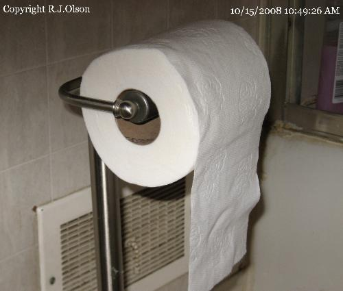 Toilet Paper Holder - Hanging to face forward.