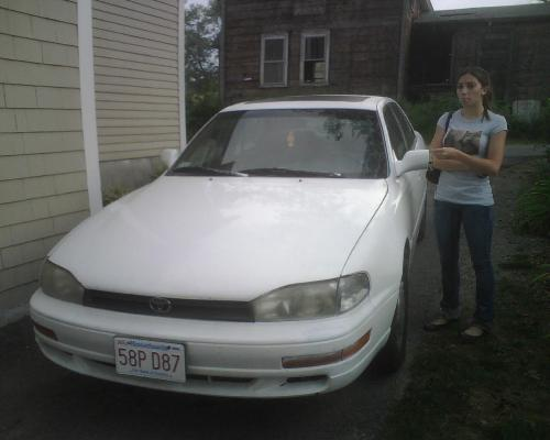daughter with her car - my daughter bought her first car