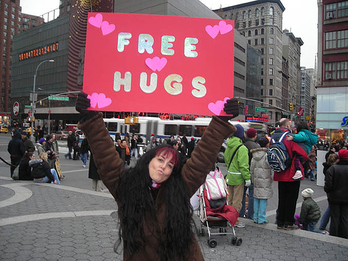 Free Hugs Campaign, USA - A photo of a girl carrying the free hugs campaign