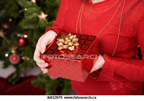 Beautiful Red wrapped Gift - Girl holding a present in red wrapping paper
