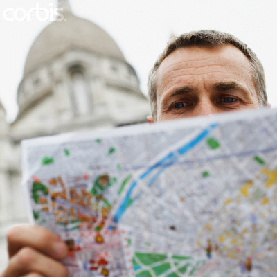 Would you step forward to help a tourist? - Photo of a tourist looking at map.
