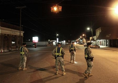 Soldiers patrol alabama - Soldiers from Rt. Rucker patrol the streets of alabam in the aftermath of latweeks shooting
