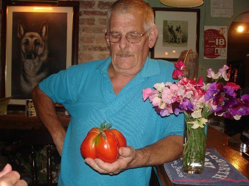 Pete's Giant Tomato (lol) - Pete holding his giant tomato in the pub.