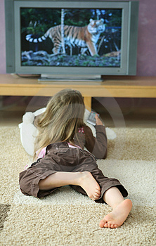 Child and TV program - This is picture is to show, how the child are addicted to the TV programs ,which involves mainly violence.