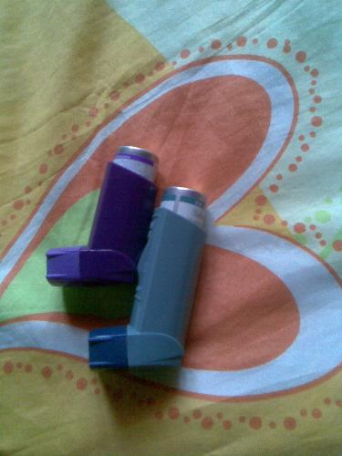 inhalers for asthma - purple with steroid seretide and ventoline inhalers