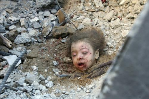 Palestinian child - this child was buried alive underneath his house ...