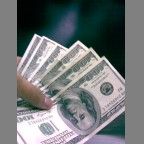 Dollars - this is my hand holding some dollars earned through freelancing, ads and bux/ptc websites :)