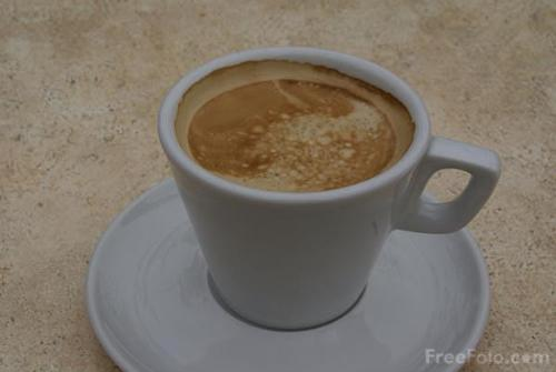 a cup of coffee - a cup having coffee