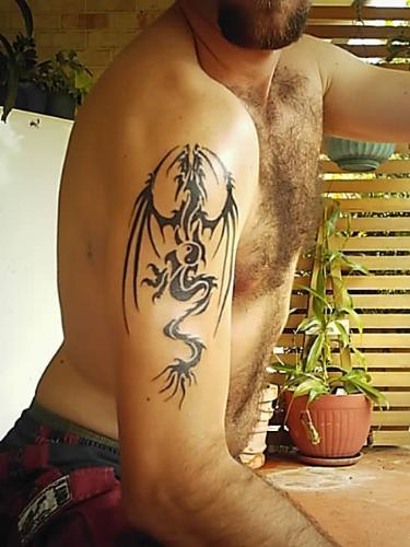 tattoo's - this sucker was a backyard job by a close yet departed friend, and it was me first, of course it hurt like hell, and he said that i was the hardest skinned person he has ever done! took him over 6hrs one night to complete!
