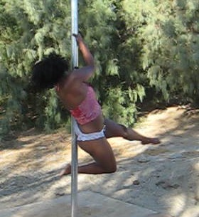 """Me doing the """"Captain Hook"""" - This trick is called the Captain Hook with both legs wrapped on one side of the pole it would be a double hook spin. It is also known as the """"Diva"""" spin."""