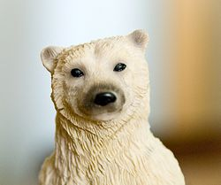 Polar Bear figurine - Photo showing the upper body part and head of a Polar Bear figurine, taken with a Nikon D80 DSLR and kit 18-135mm lens, resized down quite a bit.