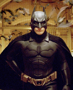 """batman - Why Batman does not use the letter """"B"""" in the Superman costume pake while writing """"S"""" in the dress costume?"""