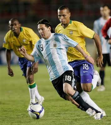Brazil an dArgentina playing a football match - One Argentinean footballer go forward to beat Brazilian defense.