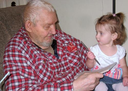 My dad - Sitting while teaching Savanna to write.