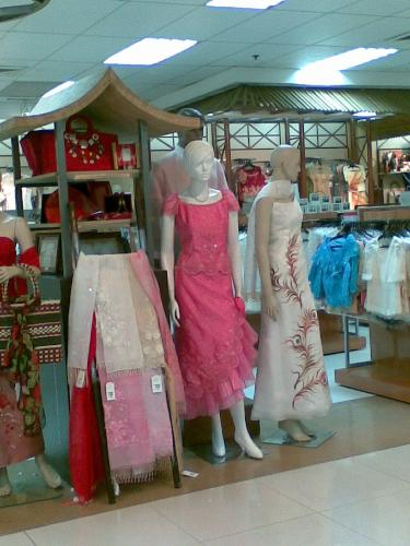 gowns - gowns on display in a mall