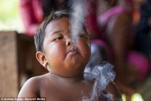 Ardi Rizal - a 2 year old baby from Sumatra Indonesia who starter smoking at 18 months. Really shocking. If he doesn't get cigarettes, he gets angry and screams and batters his head against the wall. He tells me he feels dizzy and sick.' Ardi will smoke only one brand and his habit costs his parents £3.78 a day in Musi Banyuasin, in Indonesia's South Sumatra province. But in spite of this, his fishmonger father Mohammed, 30, said: 'He looks pretty healthy to me. I don't see the problem.' Ardi's youth is the extreme of a disturbing trend.