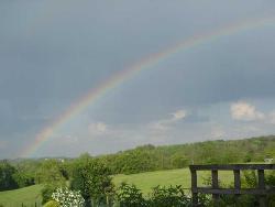 rainbow - rainbow over the grass