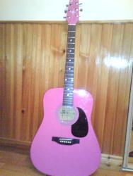 Guitar - My new pink actustic guitar that I got on tuesday!!