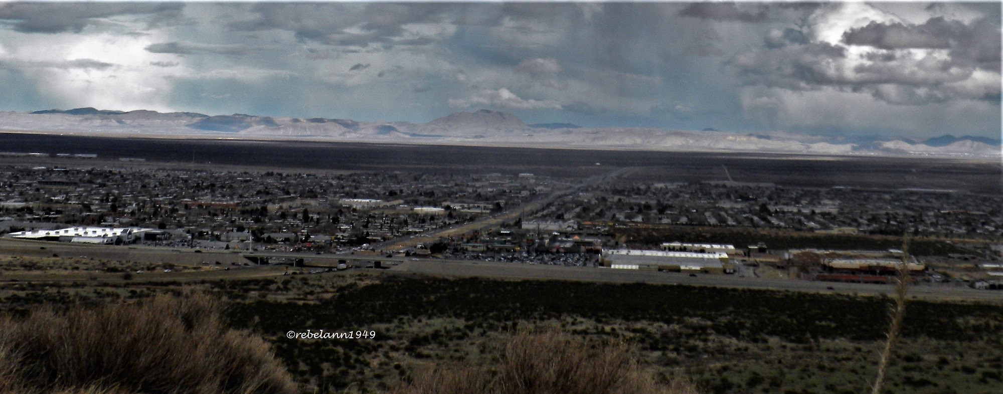 A view of northeast El Paso and the Guadalupes with rain falling, do you see it? I took this shot in Feb 2010