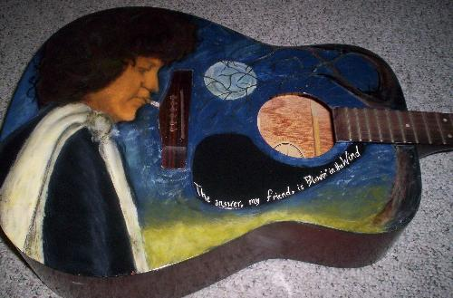 Bob Dylan on guitar - I painted this with acrylics on an acoustic guitar.