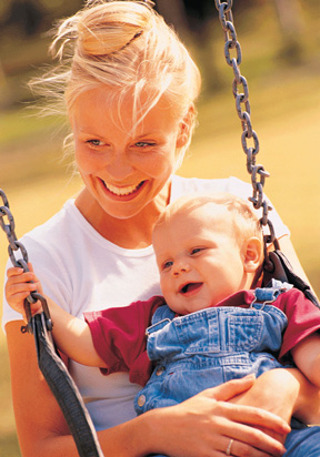 Mom and Baby - Mother and child on the swing enjoying special time together